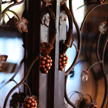 Wine cellar door architectural details of grapes