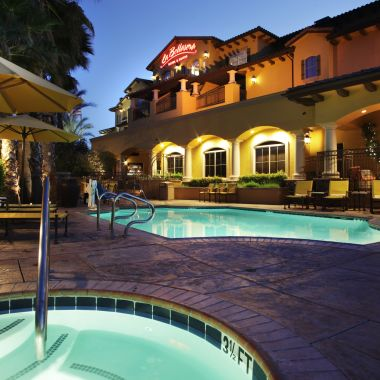 Outdoor hot tub and swimming pool at night
