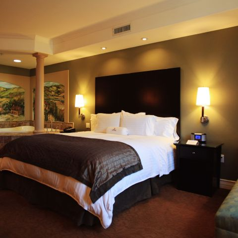 Suite with King bed and whirlpool tub and couch
