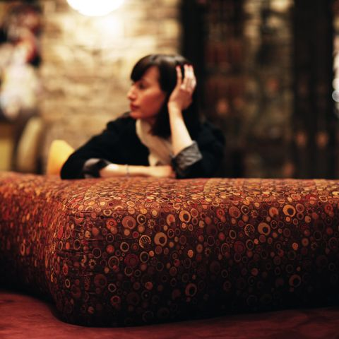 Woman sitting in hotel lobby couch