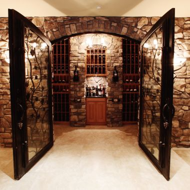 Wine cellar with doors open in hotel lobby