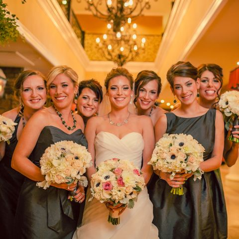 Bride and bridal party in hotel lobby